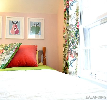 Big Girl Room Reveal- pillow from World Market napkins, ruffled bedding, DIY fruit art, World Market drapes