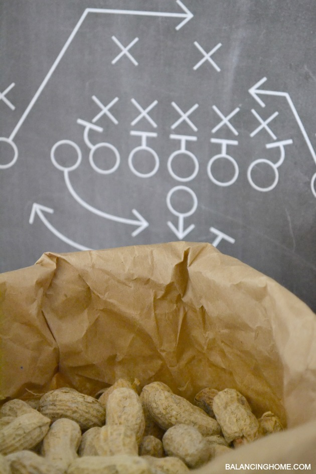 Football Party with lots of printables: Chalkboard playbook printable, varsity letter pennant printable, cupcake topper printables. Simple tips for entertaining like paper bag serving bowls, customized water bottles, and DIY tassel bunting.