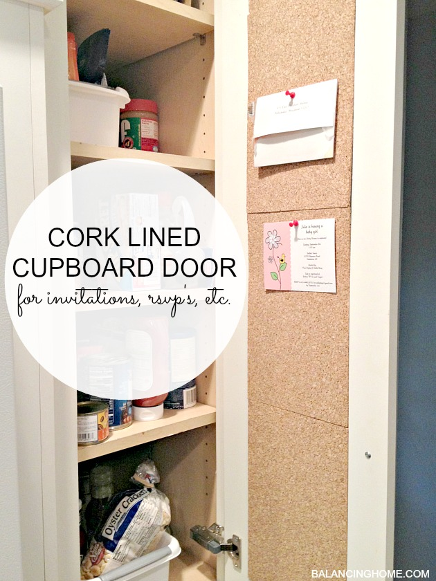 Cork-lined cupboard for corralling the papers