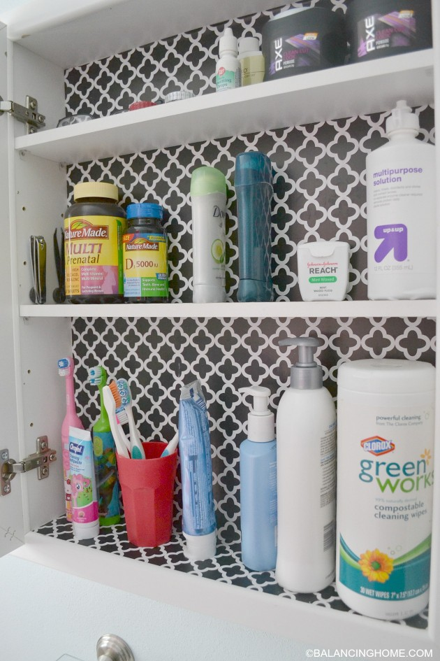 cleaning-organizing-bathroom-with-pedestal-sink-medicine-cabinet-2