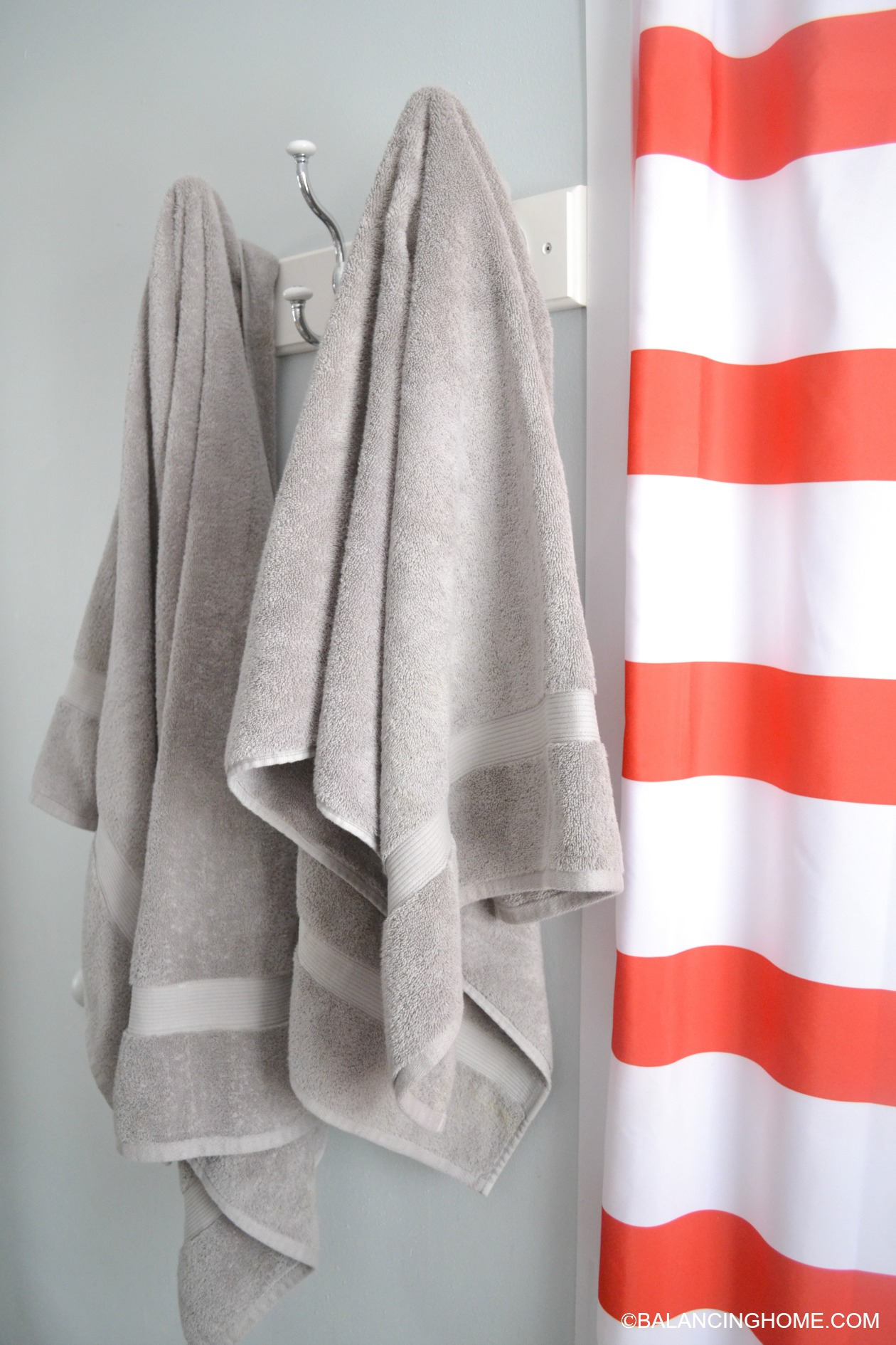 grey white striped shower curtain. cleaning organizing bathroom with pedestal sink towel hooks red white  striped shower curtain