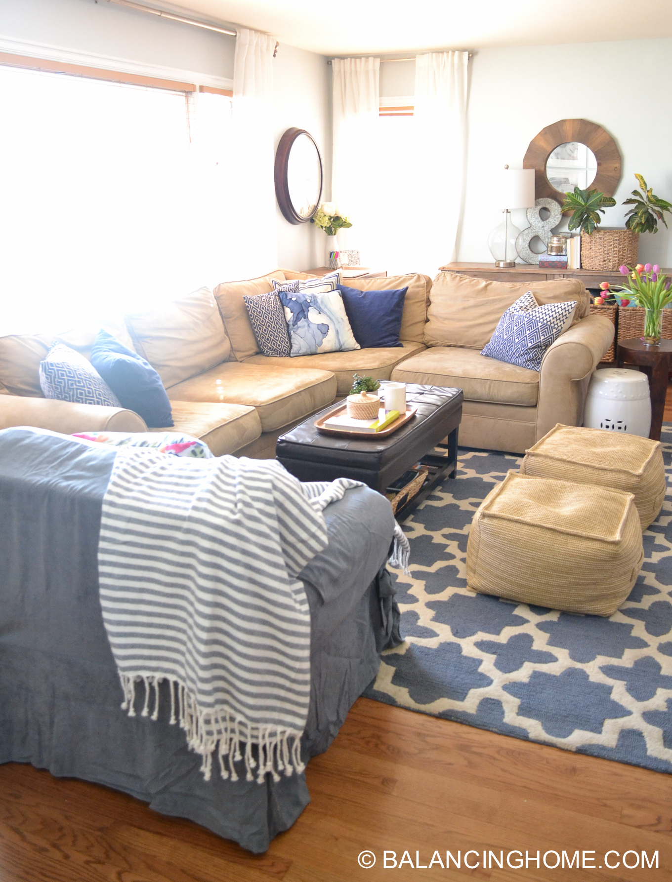 blue navy living room pops of pink family space-18