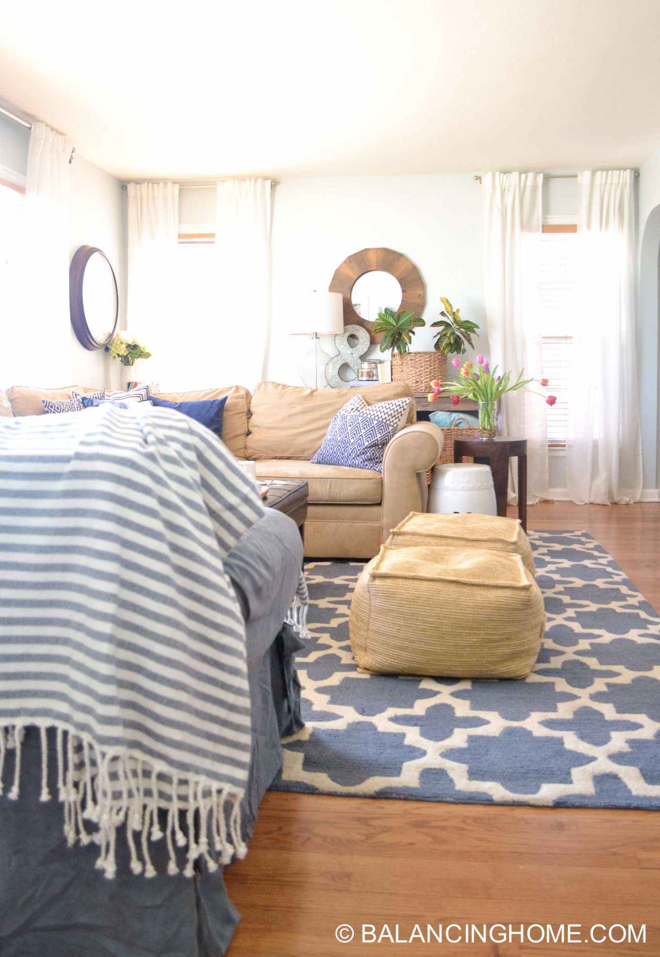 blue navy living room pops of pink family space-19