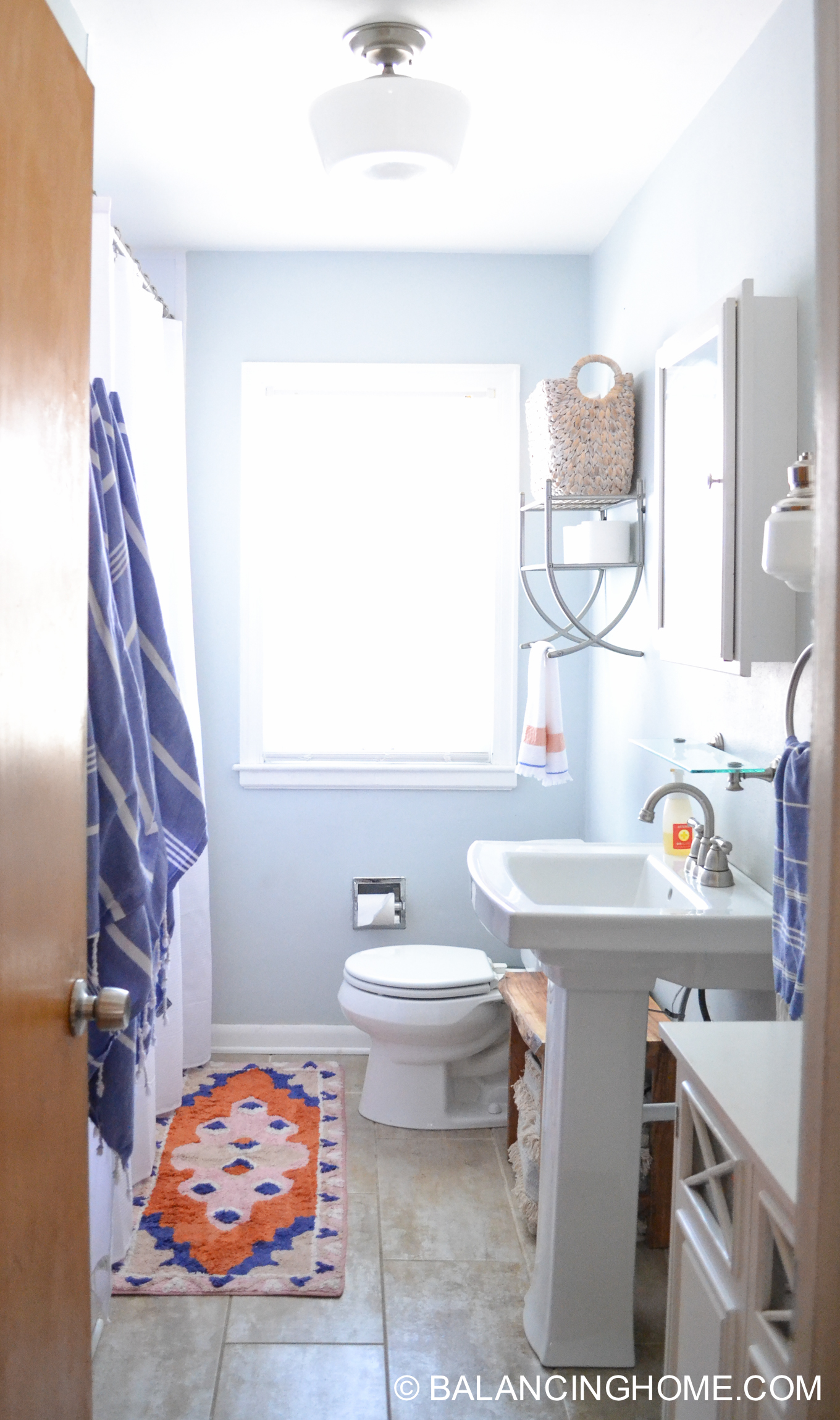 small bathroom storage and organization with pedestal sink