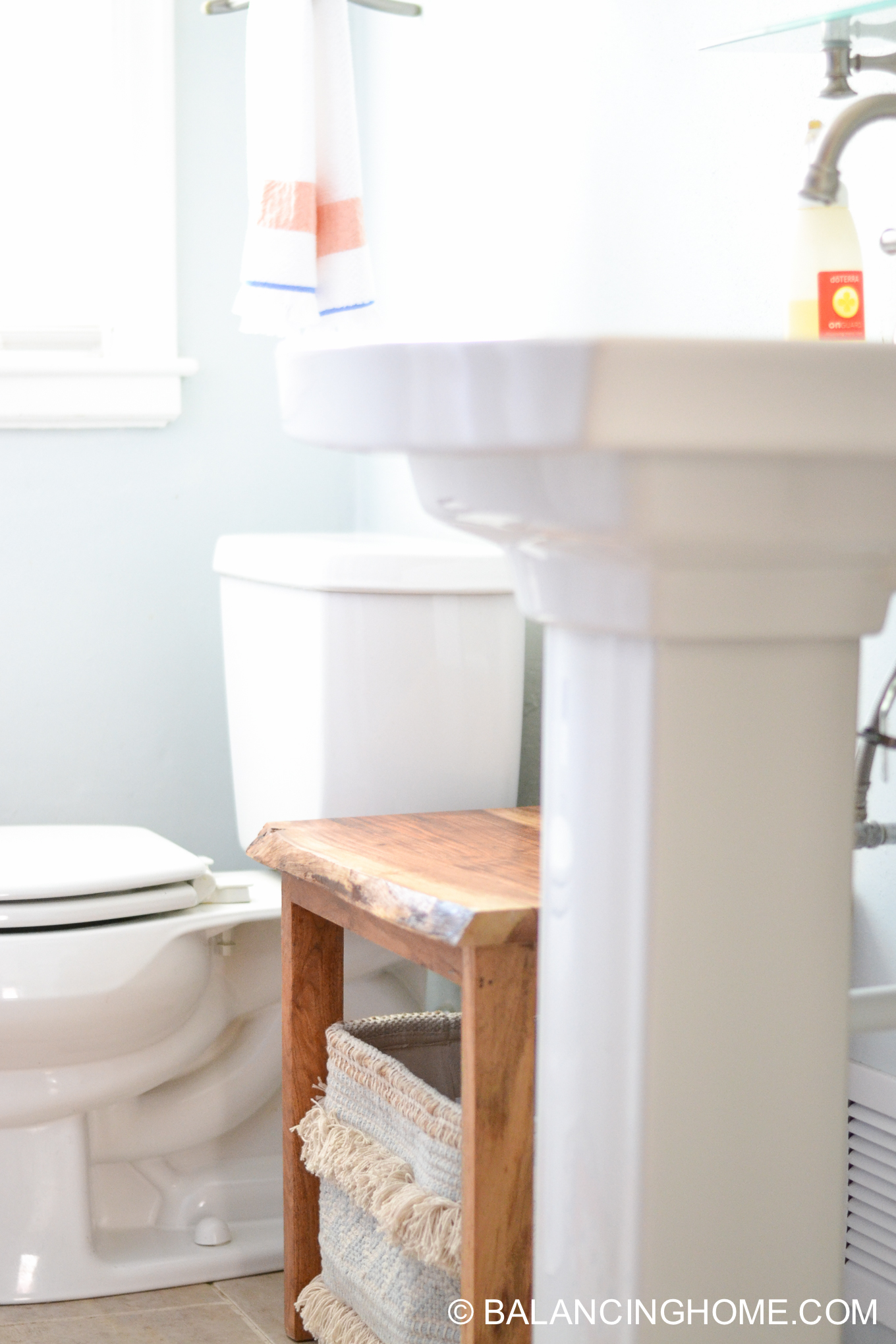 small bathroom ideas- live edge wood stool and storage hack
